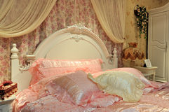 Flowery bedding room. Flowery and light pink color bedding room interior, elegance and shining style for female Stock Images