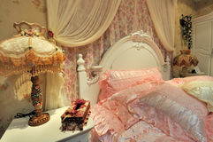 Flowery bedroom and ornaments Royalty Free Stock Photo