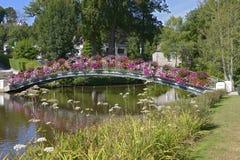 Flowery bridge at Bagnoles-de-l'Orne Stock Photos