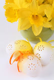 Flowery Easter eggs and daffodils Stock Photos