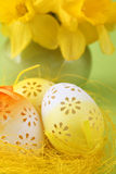 Flowery Easter eggs and daffodils Royalty Free Stock Image