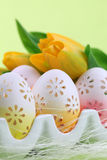 Flowery Easter eggs in an egg holder Royalty Free Stock Photo