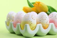 Flowery Easter eggs in an egg holder Royalty Free Stock Image