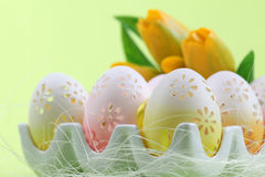 Flowery Easter eggs in an egg holder Stock Photo