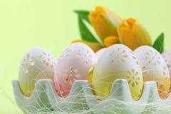 Flowery Easter eggs in an egg holder stock photo