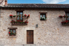 Flowery house. An old flowery house in Pedraza, Segovia (Spain Stock Photo