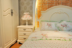 Flowery and lighting color bedding room. Interior, elegance and fine style for female Stock Photography