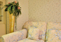 Flowery living room and sofa chair Stock Photos