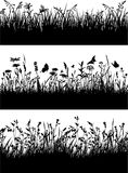 Flowery meadow silhouettes wallpaper. Seamless vector border of grass and flowers silhouettes vector illustration