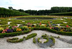 Flowery park, planted with trees, with water tanks of Bruhl castle in Germany Royalty Free Stock Photography