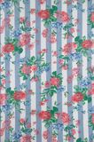 Flowery Table Cloth. Table cloth with stripes and roses pattern in blue, pink and white Stock Image