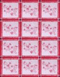 Flowery Table Cloth. Colored kitchen table cloth with red rose and stripe pattern Stock Photo
