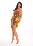 Flowery tunic. Portrait of a brunette in a colourful flowery tunic stock images