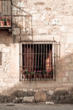 Flowery window. An old flowery window in Pedraza, Segovia (Spain Royalty Free Stock Photo