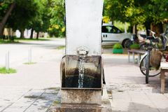 Flowing artesian well, and a spigot installed on it. Stock Photography