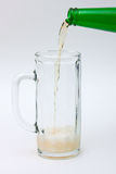 Flowing beer. Beer is flowing into a glass Stock Photo