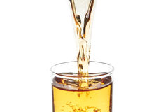 Flowing beverage. Close-up photo of the beverage flowing to the glass Royalty Free Stock Photos