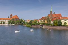 Flowing boats on the river and a view of Ostrow Tumski. Wroclaw, Poland royalty free stock photography