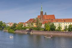 Flowing boats on the river and a view of Ostrow Tumski. Wroclaw, Poland stock images