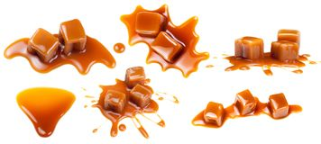 Flowing caramel sauce isolated on white background. Golden Butte. Rscotch toffee caramel liquid stock photography