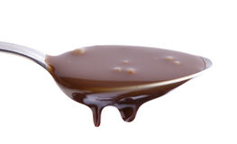 Flowing chocolate. Flowing chocolate in the spoon Stock Images