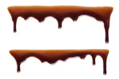 Flowing chocolate drops. Melted chocolate dripping set on white background Royalty Free Stock Photos