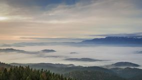 Flowing clouds in the Tatra mountains at sunrise, Poland stock video footage