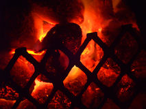 Flowing coals. Glowing coals in a griddle (or gateway to hell Stock Image
