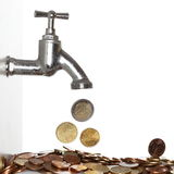 Flowing coins Stock Photo