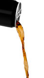 Flowing cola drink. Cola drink poring out of can Royalty Free Stock Photos