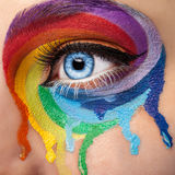 Flowing colors on an eye in fashion stage make up Royalty Free Stock Images