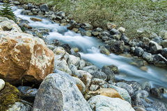 Flowing Creek of Glacier Water Stock Photo