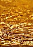 Flowing golden chocolate Stock Photos