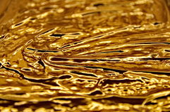 Flowing golden chocolate Royalty Free Stock Photo