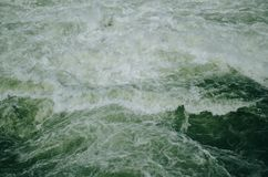 Flowing green water. River on dam Royalty Free Stock Images