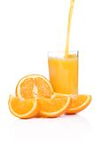 Flowing juice and orange Royalty Free Stock Photo