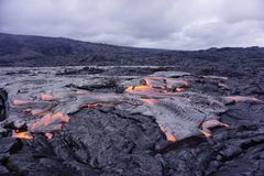 Flowing lava in Hawaii. Beautiful flowing lava creating new landscape in Big Island in Hawaii stock photos