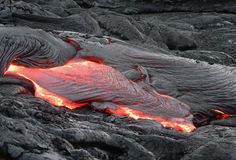 Flowing lava in Hawaii. Lava flow in Volcanoes National Park, Hawaii royalty free stock photography