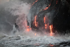 Flowing lava. Hot lava stream is flowing into the ocean. Hawaii, Big Island Stock Image