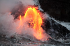 Flowing lava. Hot lava stream is flowing into the ocean. Hawaii, Big Island Stock Photography