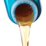 Flowing lubricating oil. Stock Photos