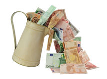 Flowing Money. Money flowing out of jug isolated on white. (lose cash concept Stock Photo