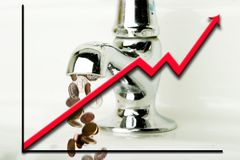 Flowing Money. Money flowing out of a retro bathroom tap with a graph going up overlayed Stock Photo