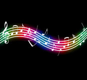 Flowing Music Notes. On black background Stock Photography