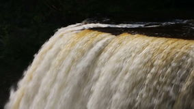 Flowing Over Tahquamenon`s Edge Loop stock footage