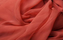 Flowing red fabric Stock Images