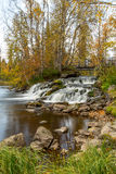 Flowing river and autumns colors Stock Photos