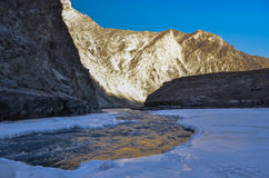 Flowing river inside frozen river chadar trek Royalty Free Stock Photos