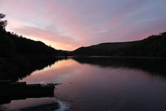 Flowing river reservoir with small waterfall at sunset.Peak district. Derwent Valley. Stock Image
