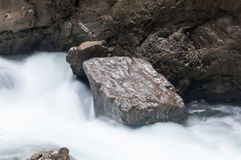 Flowing river between rocks Royalty Free Stock Photos